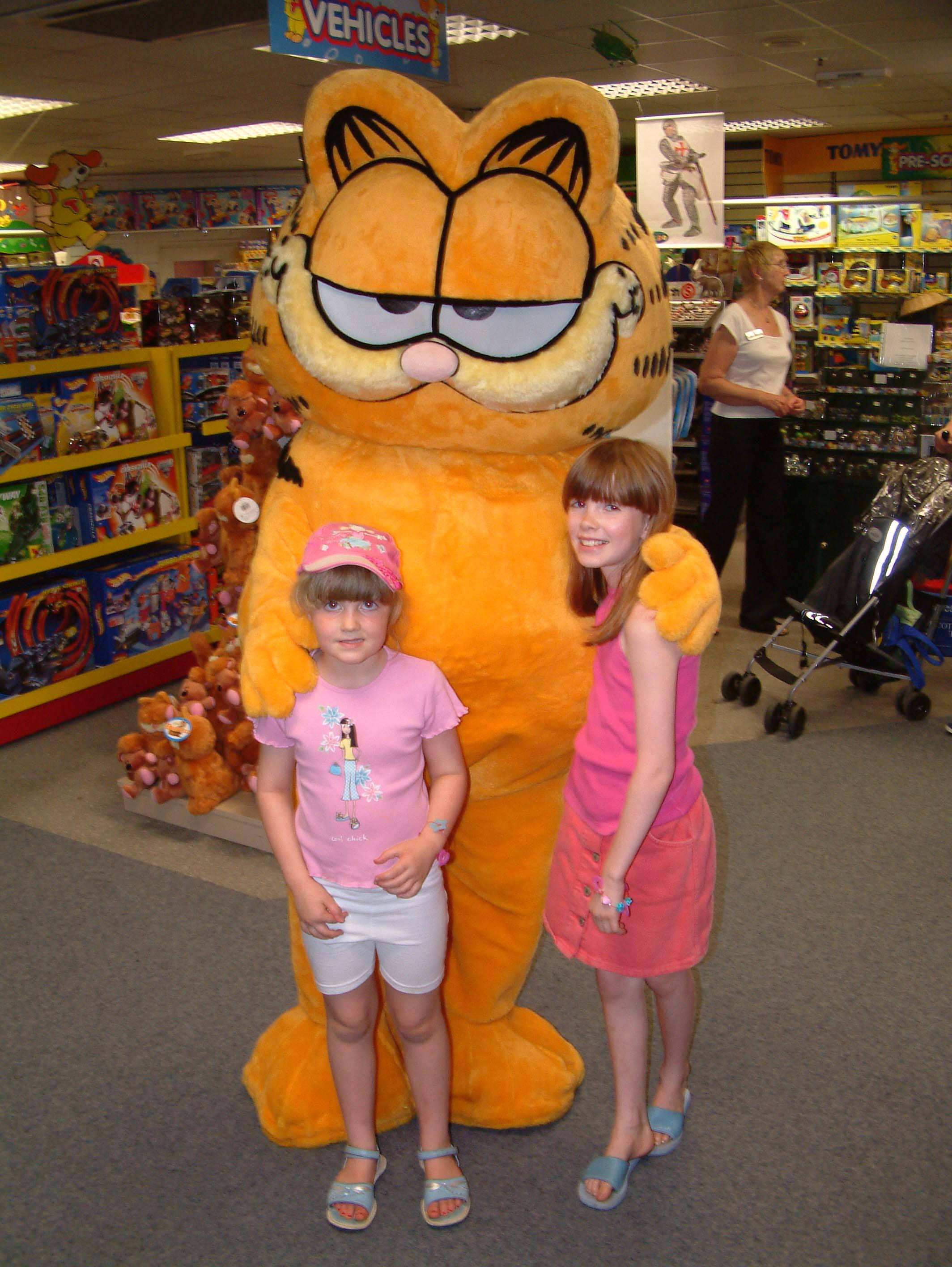 Garfield costume character mascot meets young fans in-store