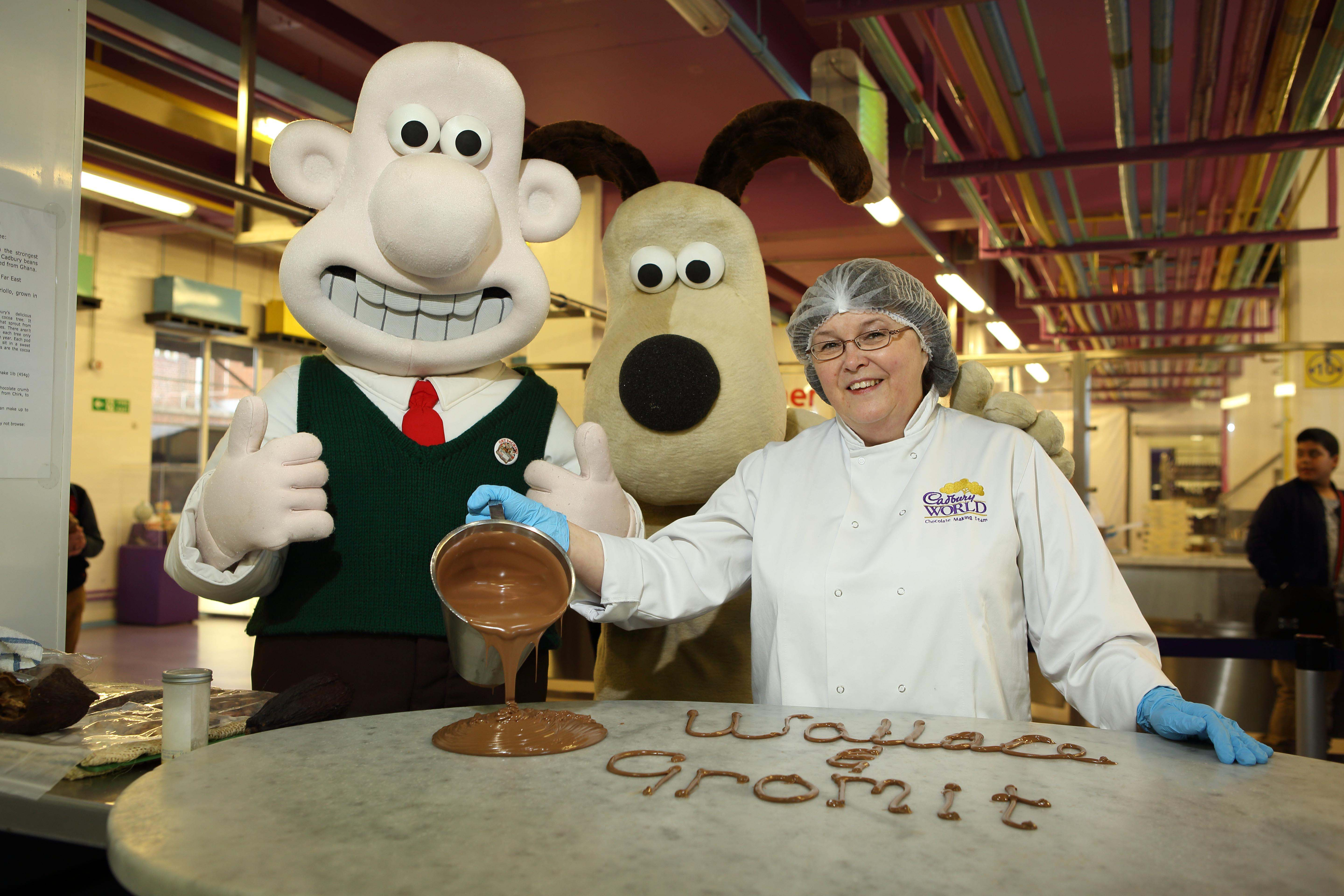 Wallace and Gromit mascots make chocolate